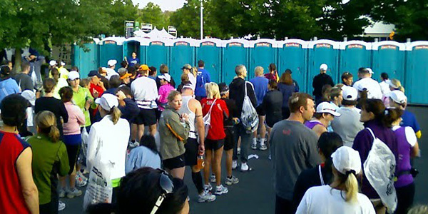 runners waiting for the porta potties