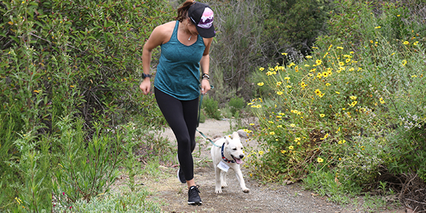 running_with_dog_on_trail