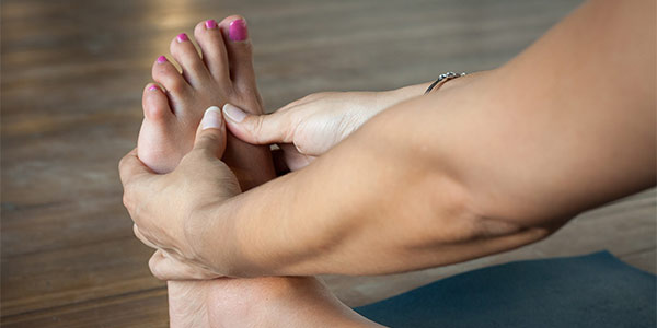 woman_massaging_foot