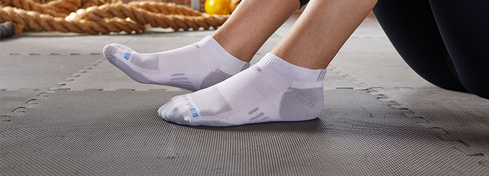 Man and Woman wearing R-Gear Socks - 90 Day Perfect Fit Promise